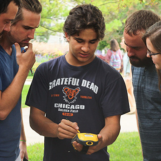 student using handheld GIS system